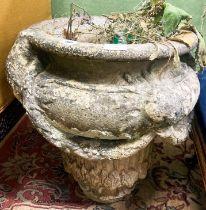 A reconstituted stone garden planter, diameter 50cm H.54cm