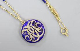 A yellow metal, blue enamel and rose cut diamond set monogrammed circular locket (a.f.) 29mm, on a