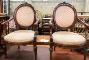 A pair of 19th century French walnut upholstered elbow chairs, W.62cm D.50cm H.102cm