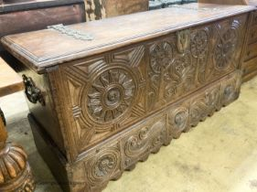 A 17th / 18th century Welsh oak coffer, with carved panelled front and heavy brass strap hinges, W.