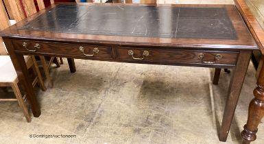 A reproduction oak two drawer writing table, W.160cm D.80cm H.78cm
