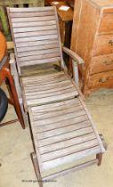 A weathered teak folding garden steamer chair