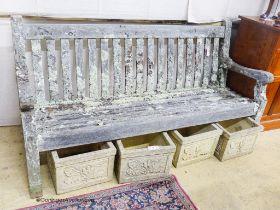 A weathered teak garden bench, length 182cm, depth 68cm, height 94cm
