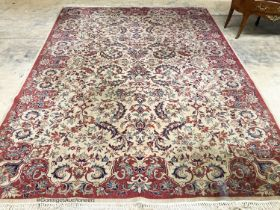 A Persian style ivory ground carpet, 380 x 280cm