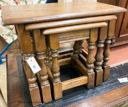 A nest of three reproduction rectangular oak tea tables, largest W.60cm W.32cm H.45cm