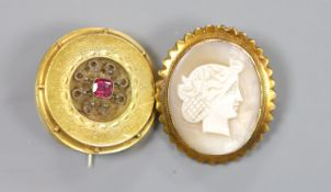 An early 20th century 9ct mounted oval cameo shell brooch, 36mm and an earlier yellow metal and gem