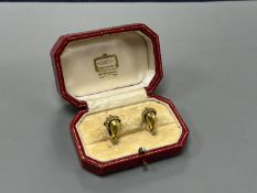 A modern pair of gilt metal earrings, together with a Cartier gilt tooled red leather jewellery