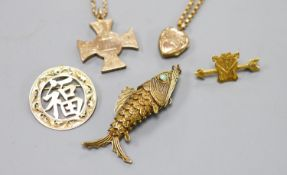 A Scottish yellow metal cross pendant on a 9c chain, a similar heart locket on a gilt metal chain, a