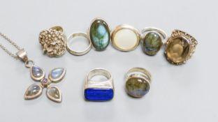 Six assorted white metal and gem set dress rings, a white metal band and dress ring and a white