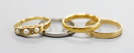 A 22ct gold wedding band, 4.8 grams, two 18ct gold rings including split pearl and diamond, gross