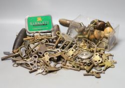 Assorted watch keys and winders and a corkscrew