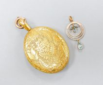 A Victorian engraved yellow metal oval locket, with engraved initials, 47mm, gross 31.6 grams,