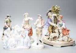 A Sitzendorf group of a Shepherd and shepherdess, three other Continental costume figures and a