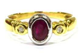 A RUBY AND DIAMOND THREE STONE 18CT GOLD RING the oval cut ruby approx. 7 x 5mm, with two small