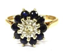 A 9CT GOLD DIAMOND AND SAPPHIRE CLUSTER RING the centre illusion set small diamond with sapphire