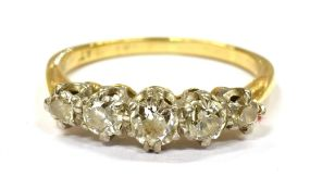 A DIAMOND FIVE STONE 18CT GOLD RING the five graduating round brilliant cut diamonds weighing a