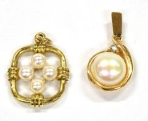 TWO SMALL CULTURED PEARL SET GOLD PENDANTS comprising a single button shaped pearl set with very