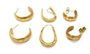 THREE PAIRS OF 9CT GOLD EARRINGS comprising two pairs of hoops and pair of creoles of hollow
