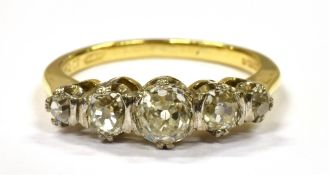 A DIAMOND FIVE STONE 18CT GOLD RING OF 1.5 CARAT Comprising five round old cut diamonds graduating