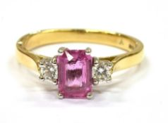 A PINK SAPPHIRE AND DIAMOND THREE STONE RING the rectangular cut cornered pink sapphire approx. 7