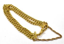 A 18CT GOLD TWO ROW TWISTED CURB LINK BRACELET with toggle fastener, 18ct gold hallmarks to