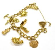 A 9CT GOLD CHARM BRACELET with seven charms and a padlock fastener, five of the charms hallmarked or