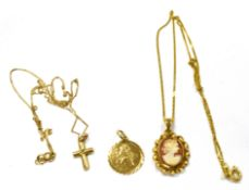 THREE 9CT GOLD PENDANTS Two with 9ct gold chains, comprising a cross with a very small