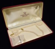 A SINGLE ROW CULTURED PEARL NECKLACE with two 9ct gold oval snap clasps, the uniform cultured