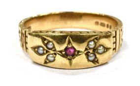 A MODERN 9CT GOLD SMALL RUBY AND SEED PEARL SET BAND RING the bead set front all in one to yellow