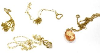 THREE 9CT GOLD SMALL PENDANTS AND CHAINS together with a fine link chain, comprising an oval cameo