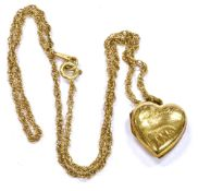 A 9CT GOLD CHAIN ON A SMALL 9CT BACK AND FRONT HEART SHAPED LOCKET The Prince of Wales link