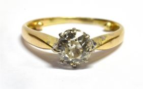 A 0.75 CARAT DIAMOND SOLITAIRE GOLD RING the round old brilliant cut diamond, assessed colour H/I,