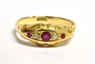A C1900 RUBY AND DIAMOND SET BOAT HEAD RING the central ruby approx. 3mm diameter, the shank stamped