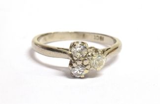 A DIAMOND THREE STONE 18CT WHITE GOLD RING A triangle of three round brilliant cut diamonds with a