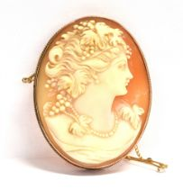 A 9CT GOLD CAMEO BROOCH The oval shell cameo 5 cms X 4 cms, applied pad to mount stamped 9ct,