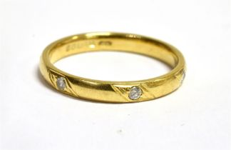 A HALLMARKED 18CT GOLD DIAMOND SET WEDDING BAND The D profile band 3mm wide bead set with three