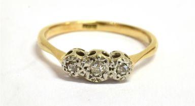 A DIAMOND THREE STONE ILLUSION SET 18CT GOLD RING Three small round old cut diamonds, 18ct yellow