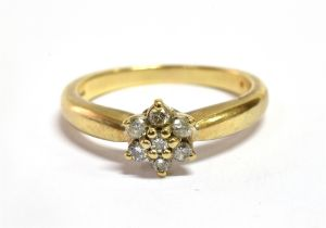 A DIAMOND FLOWERHEAD CLUSTER 9 CARAT GOLD RING Cluster comprising seven round brilliant cut