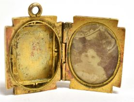 A VICTORIAN LOCKET the rectangular locket with raised front, monogrammed initials, assessed as