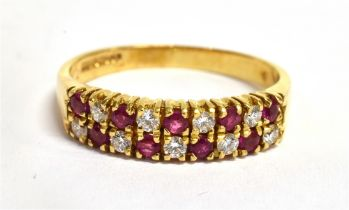 A RUBY AND DIAMOND TWO ROW 18CT GOLD HALF ETERNITY RING The front section comprising two rows of