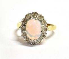 AN OPAL AND DIAMOND CLUSTER 18CT GOLD RING the oval cluster comprising a centre cabochon cut opal, 9