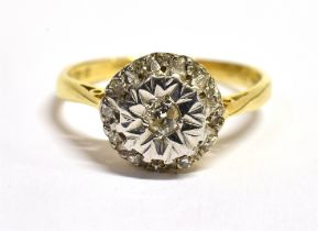 A DIAMOND ILLUSION SET CLUSTER RING The small round brilliant cut centre diamond illusion set to