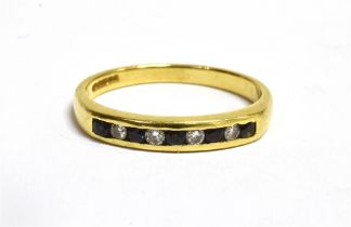A HALLMARKED 18CT GOLD SAPPHIRE AND DIAMOND SET HALF ETERNITY RING The channel set half eternity