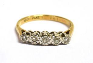 A DIAMOND FIVE STONE 18CT GOLD RING The five small illusion set eight cut diamonds 0.16 carat total,