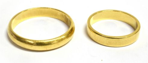 TWO 18CT GOLD PLAIN WEDDING BANDS the larger of D profile, 4mm wide, size T, the smaller with