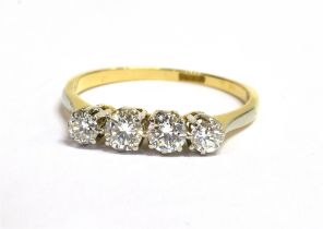 A DIAMOND FOUR STONE 18CT GOLD RING the four round brilliant cut diamonds weighing a total of