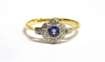 AN ART DECO SMALL SAPPHIRE AND DIAMOND SET CLUSTER RING The small central round cut sapphire with