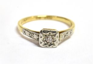 A DIAMOND ILLUSION SET SINGLE STONE 18CT GOLD RING The square head with a small old cut diamond to
