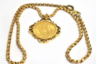 A FULL SOVEREIGN PENDANT In a 9ct gold mount on a 9ct gold chain with applied pad stamped 9C,