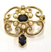 A MODERN SAPPHIRE AND CULTURED PEARL 9CT GOLD PENDANT BROOCH The open scroll design of quatrefoil